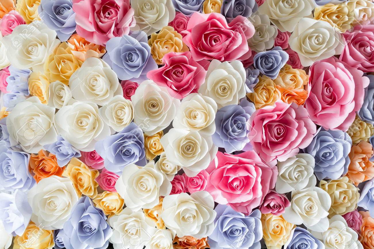 Backdrop Of Colorful Paper Roses Background In A Wedding Reception
