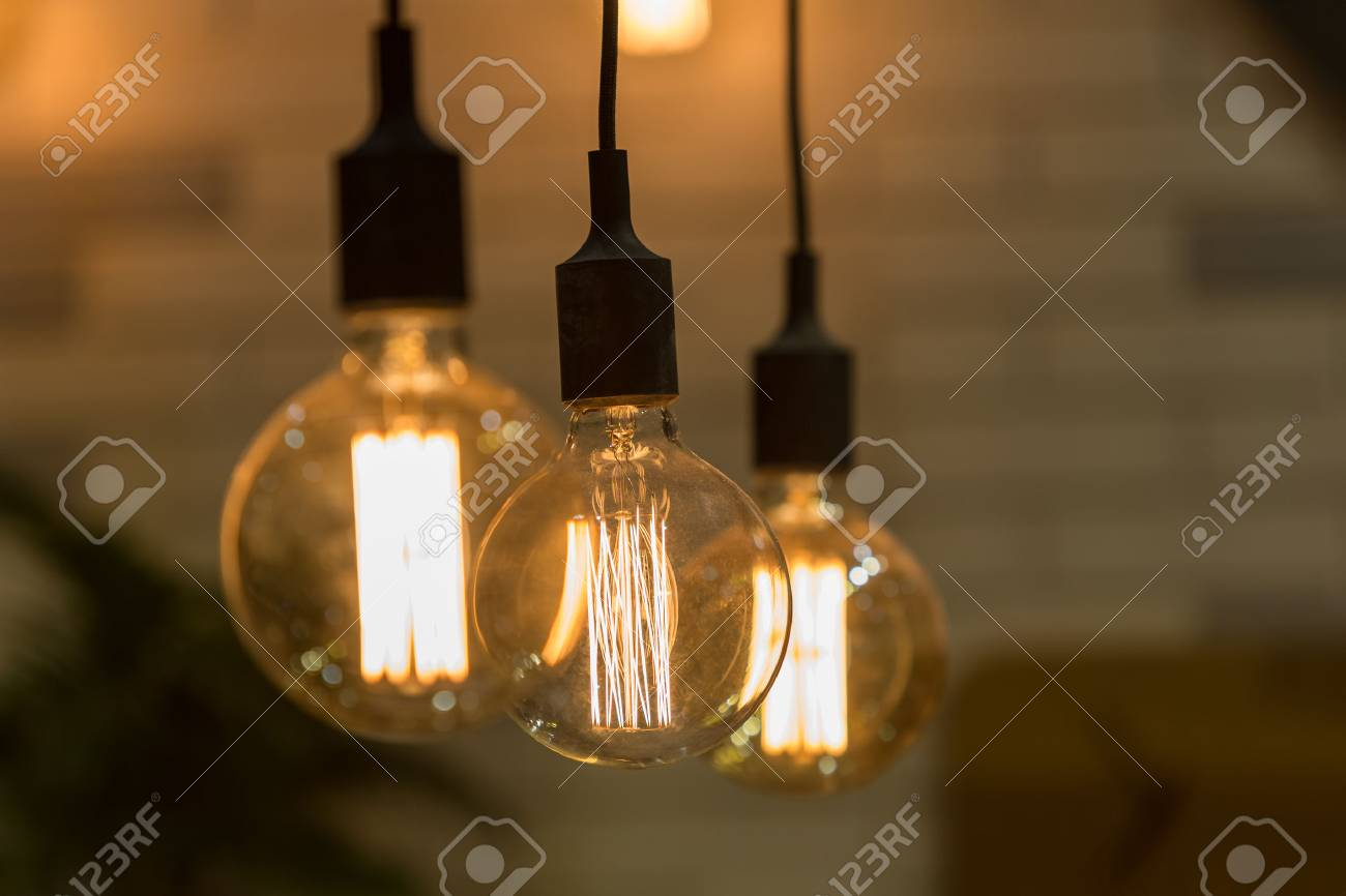 vintage style light bulbs hang and decorated in a living room stock