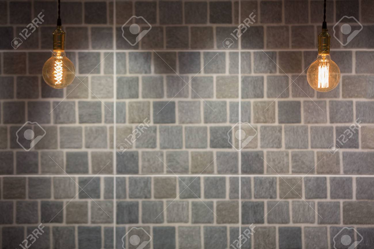 Industrial and vintage style lighting bulbs with stone tiles