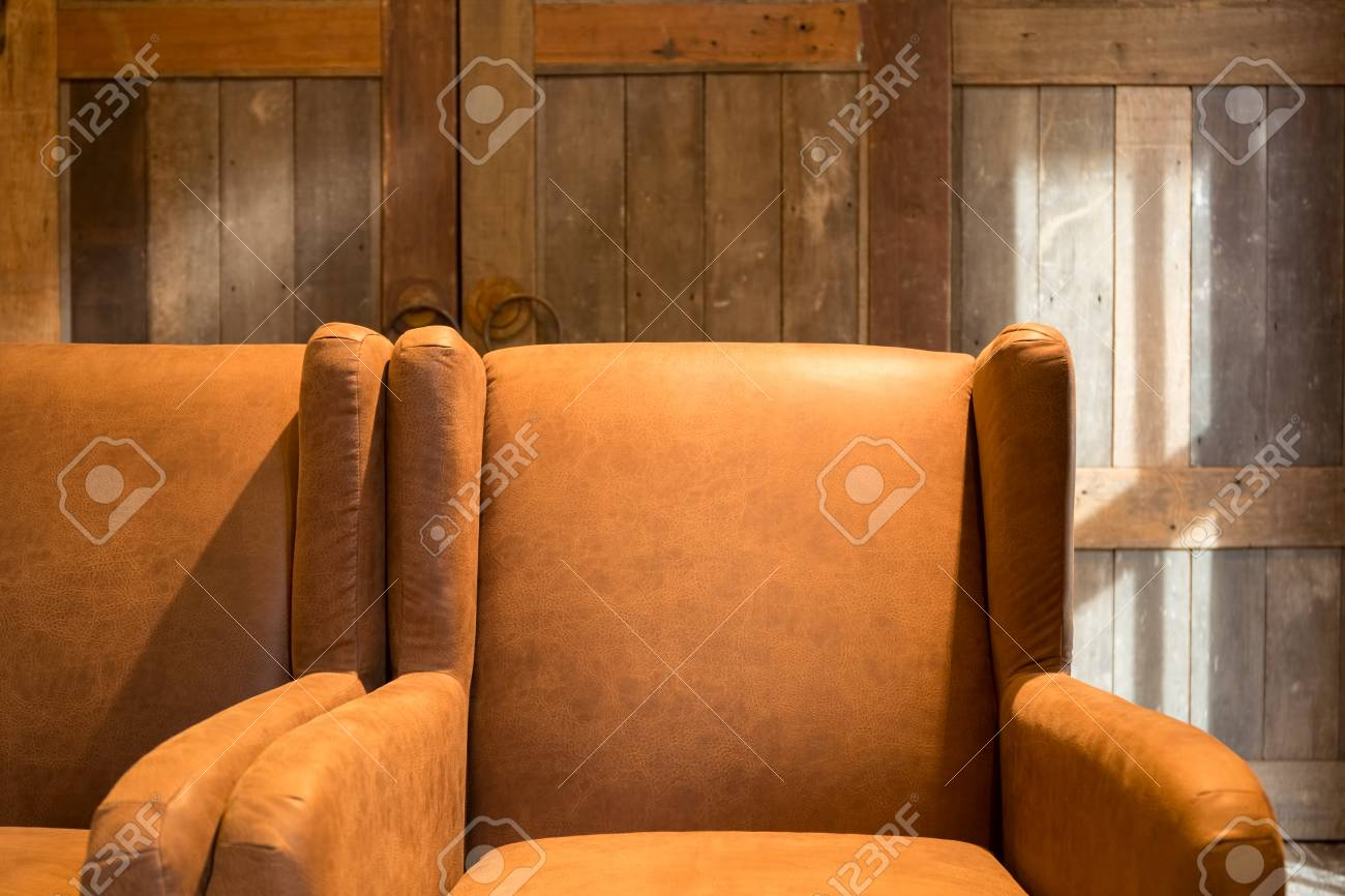 Vintage Brown Leather Armchair In A Rustic Log Cabin Home Living