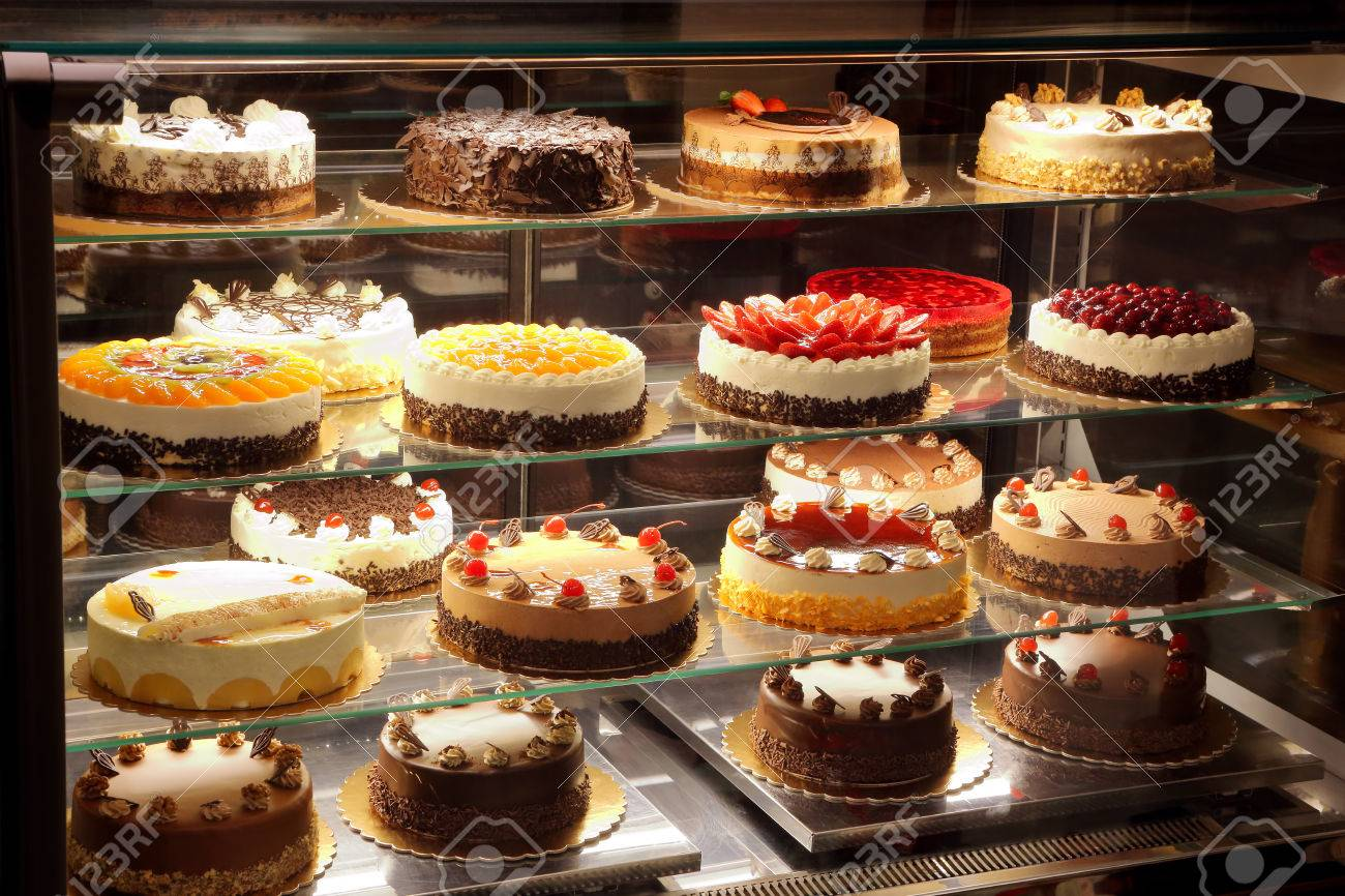 Different Types Of Cakes In Pastry Shop Glass Display Stock Photo