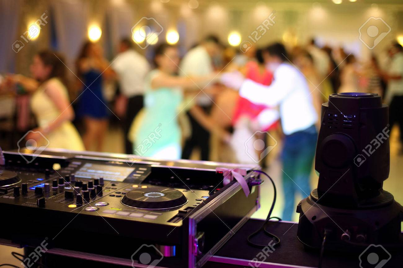 Dancing couples during party or wedding celebration by dj mixer - 64225529