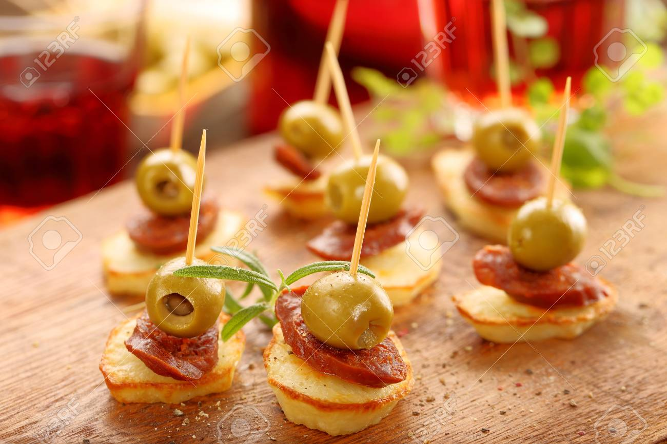 baked potatoes spanish snack with sausage chorizo and green olive