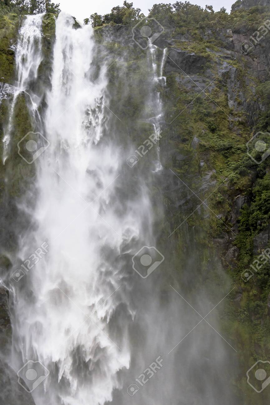 Waterfalls At Milford Sound At Fiordland National Park In Southwestern