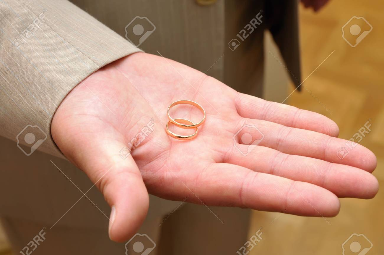 Stretched Grooms Hand With Wed Rings On Stock Photo, Picture And ...