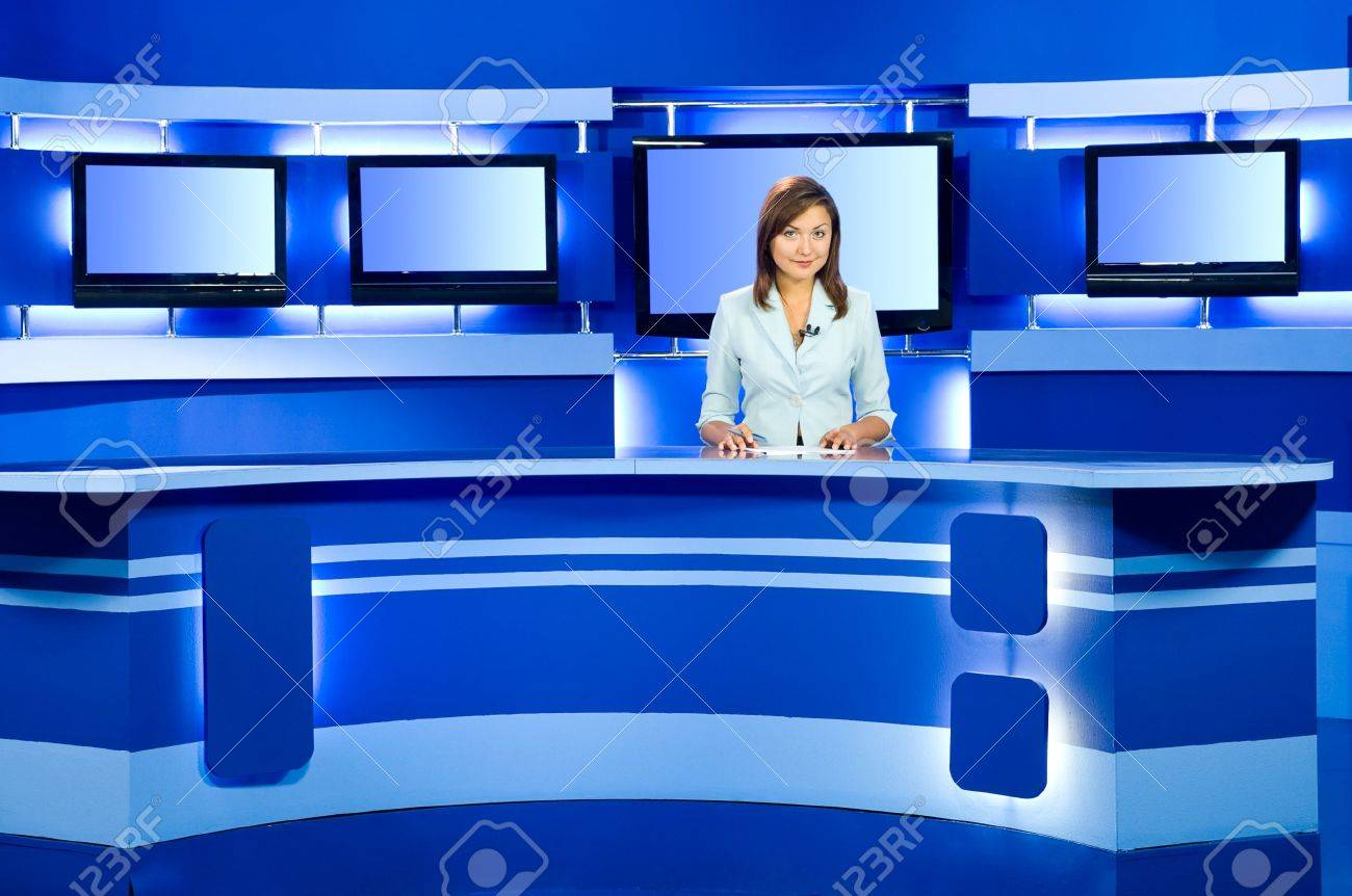 television anchorwoman at studio during live broadcasting Stock Photo - 5812548