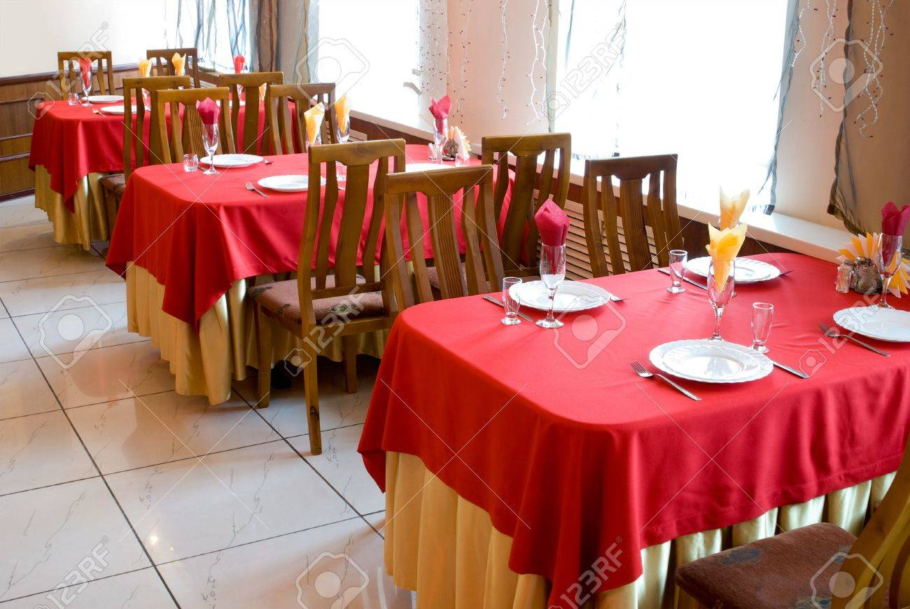 restaurant interior with red and beige tablecloths stock photo