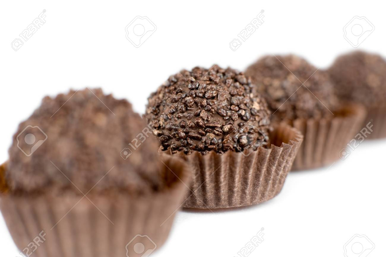 a line of chocolate round sweets in perspective, super macro Stock Photo - 6940755