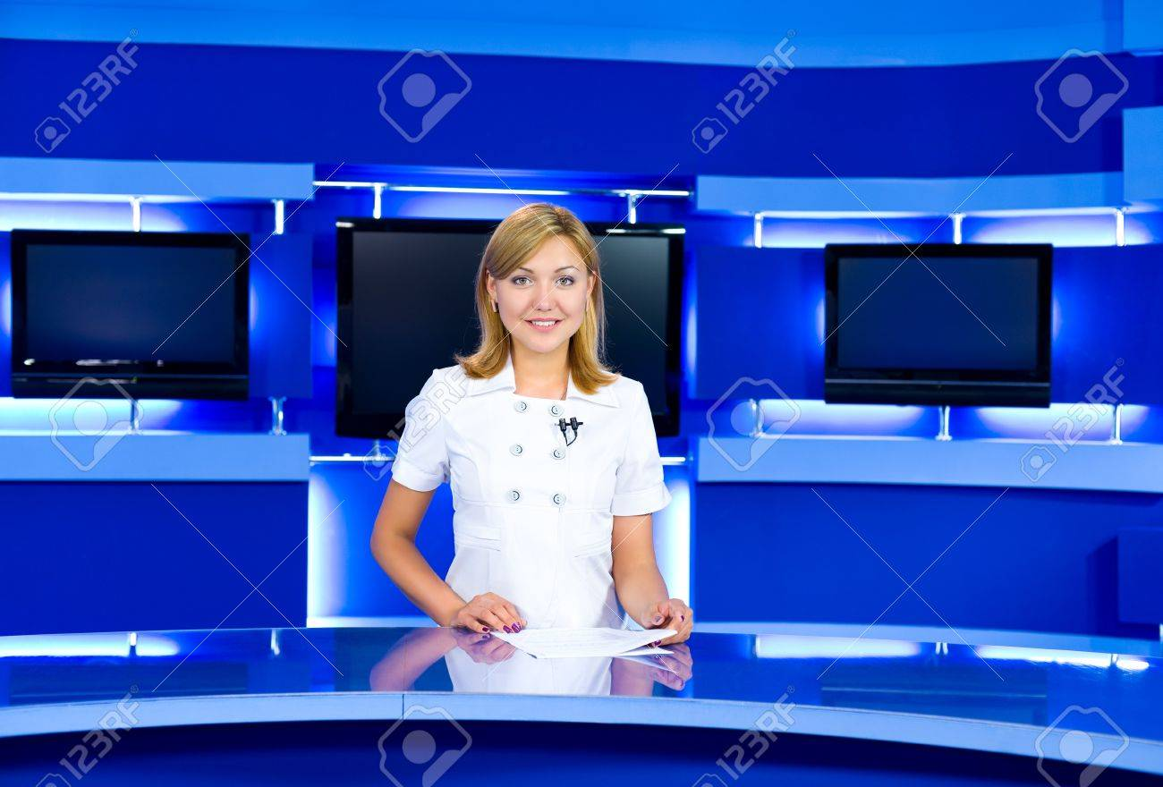 a television anchorwoman at studio during live broadcasting Stock Photo - 7352456