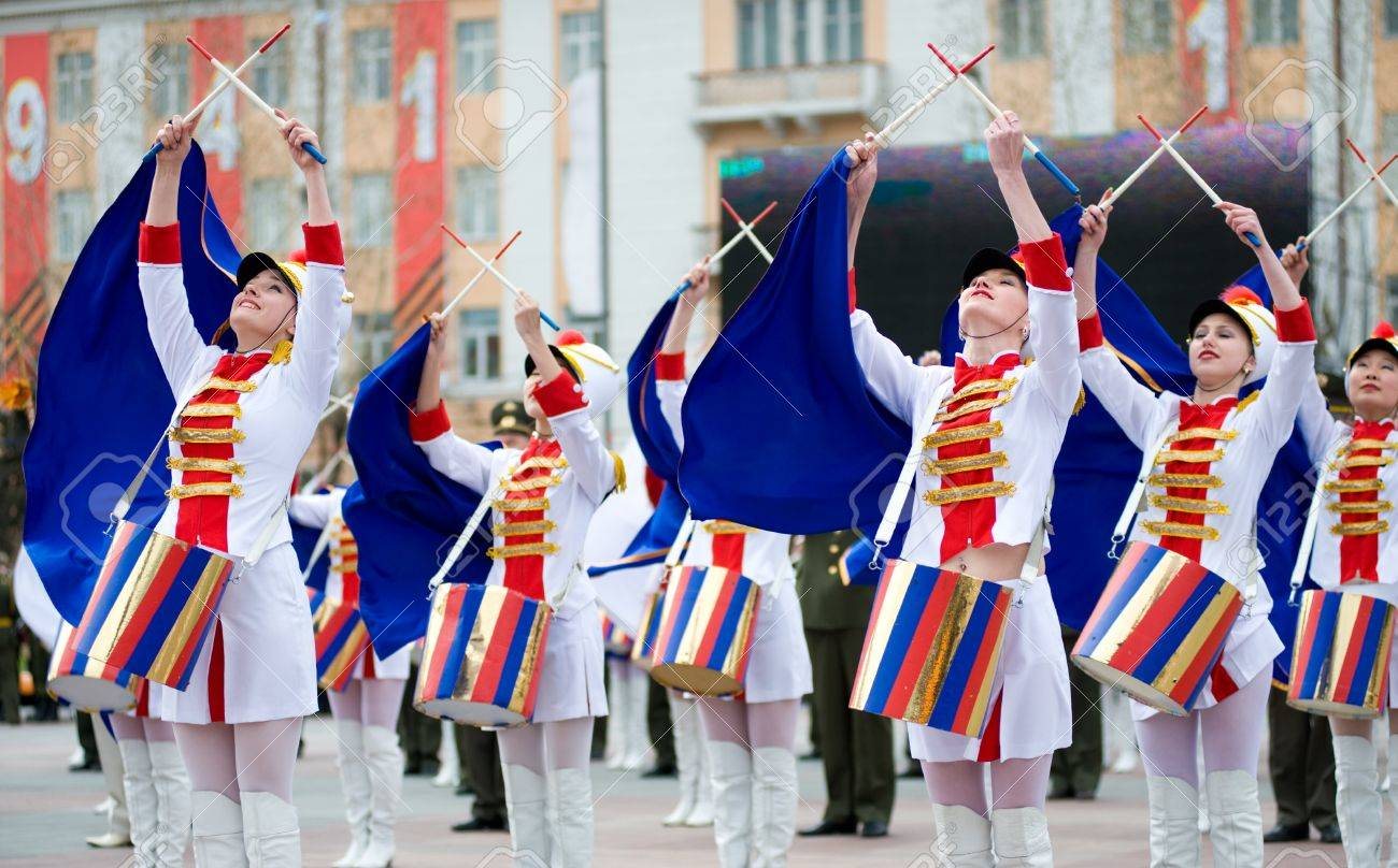 ULAN-UDE, RUSSIA - MAY 9: Young drummer girls at the parade on annual Victory Day, May, 9, 2010 in Ulan-Ude, Buryatia, Russia. Stock Photo - 8779886