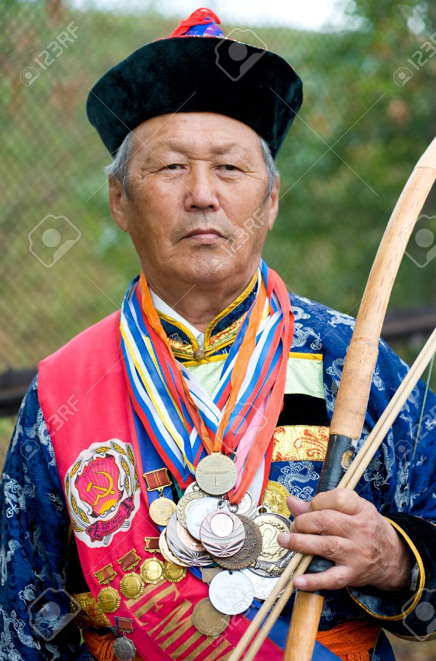 ULAN-UDE, RUSSIA - JULY 16: The 4th General Session of the World Mongolians Convention, July 16, 2010 in Ulan-Ude, Buryatia, Russia. An unidentidied participant in the Mongolian archery competition.  Stock Photo - 8790763