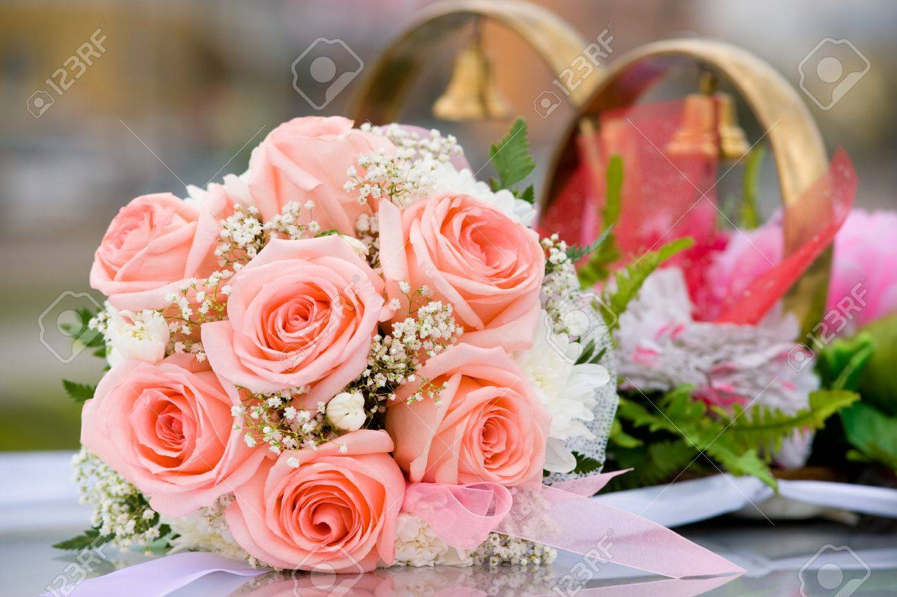 Brides Bouquet Of Roses Against Car Wedding Decoration Stock Photo ...