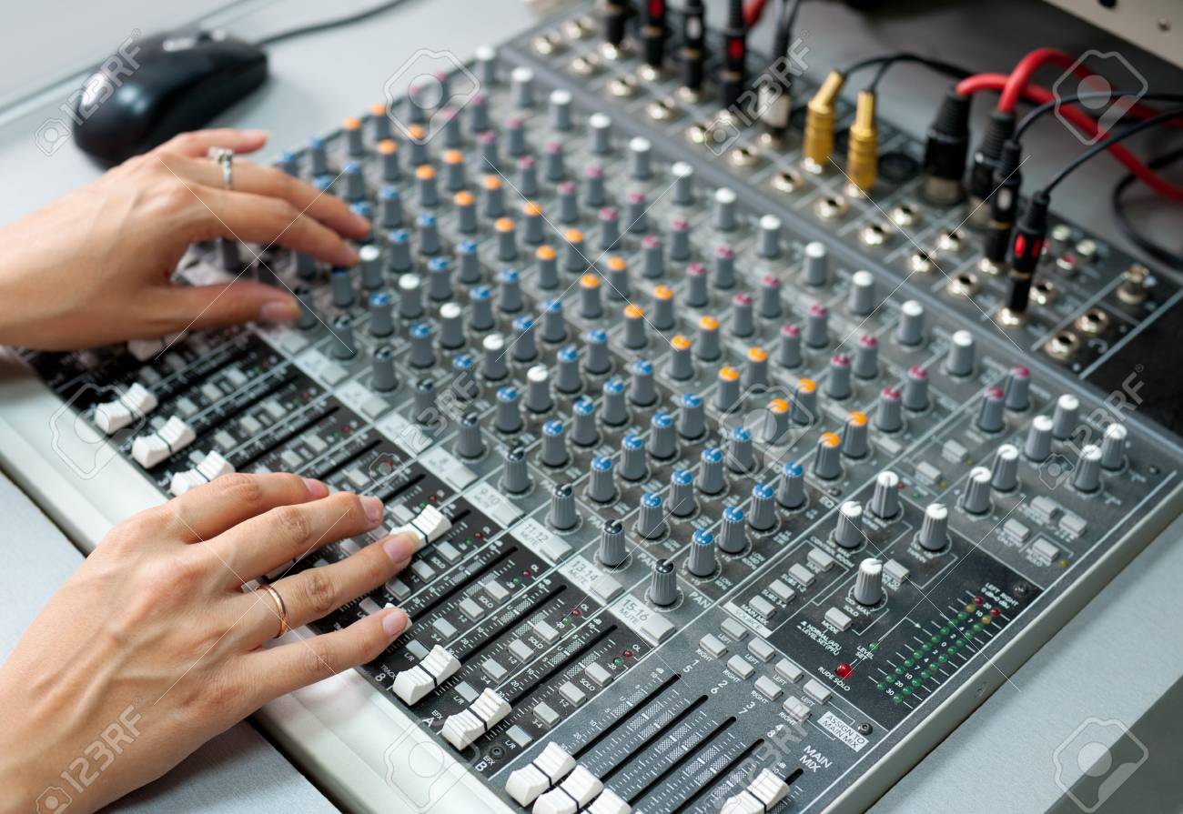 female hands at a sound mixing console Stock Photo - 11100025