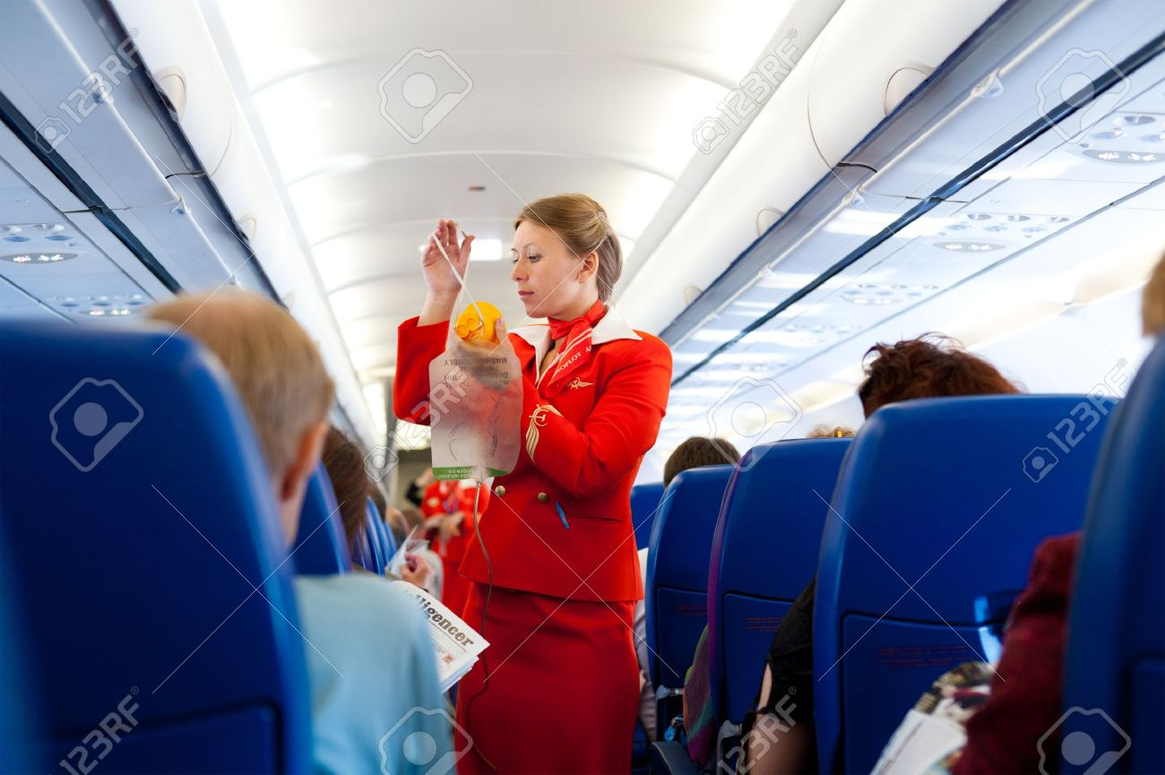 aeroflot attendant MOSCOW - MAY 28: Unidentified air hostess of Aeroflot shows how to use an  oxygen