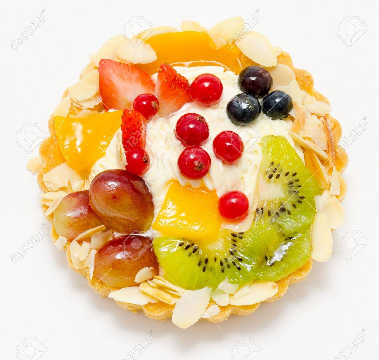 a short pastry basket filled with cream, fruit and berries Stock Photo - 12540598