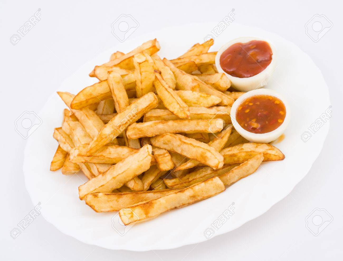 French Fried Potatoes Served With Ketchup In Onion Halves Stock Photo 12540670