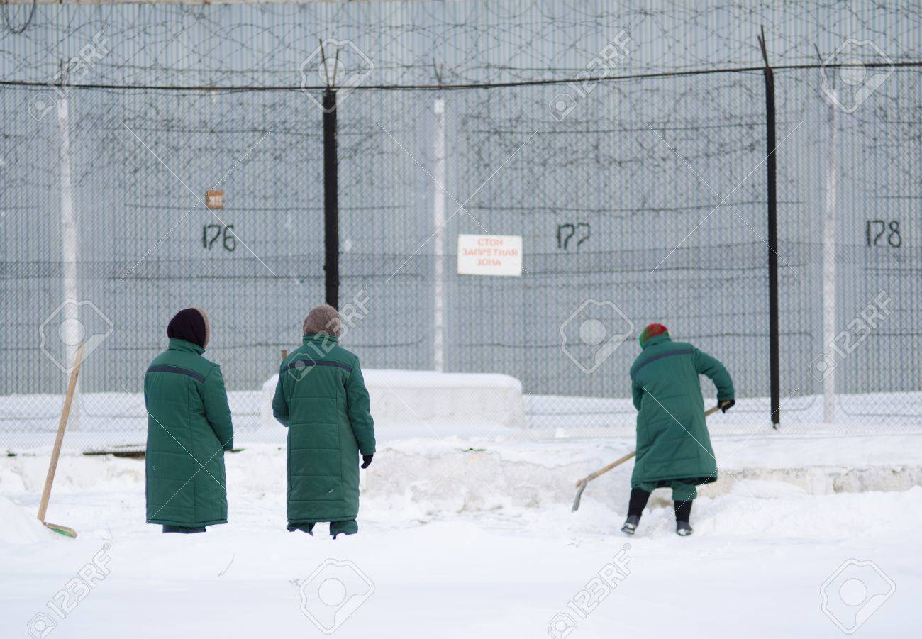 snow removal at a female prison, three women work Stock Photo - 12817051