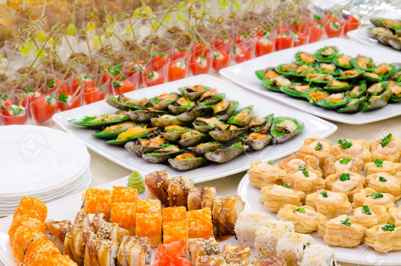 a lot of cold snacks on buffet table, catering Standard-Bild - 12944627
