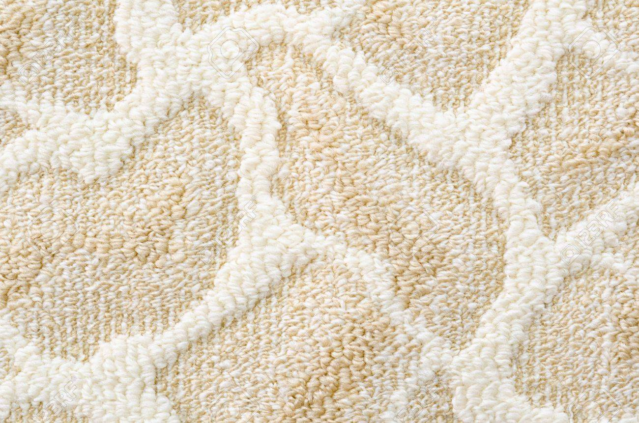 carpet pattern. a beige floor carpet with relief pattern stock photo - 14115223