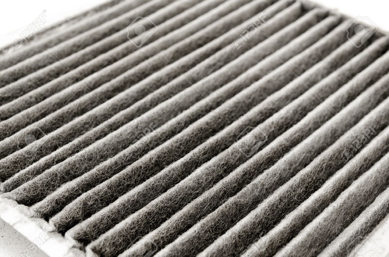 an old dirty air filter for cars Stock Photo - 15701578
