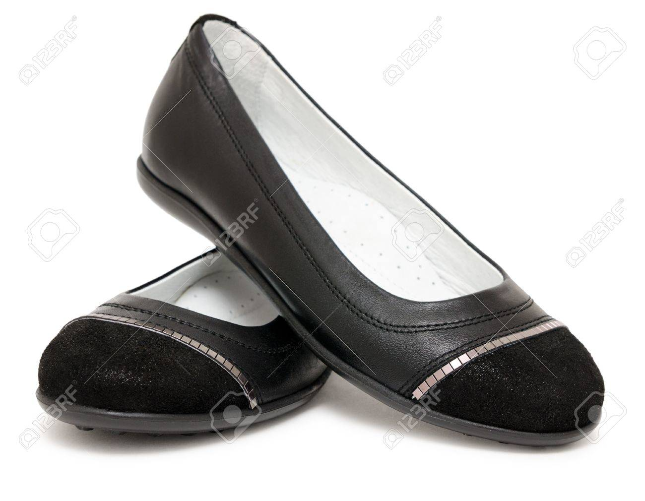 A Pair Of Black Flat Ladies Shoes Stock