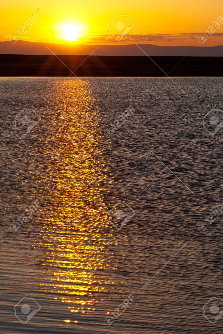 Baikal sunset - sun goes down over water Stock Photo - 17549271