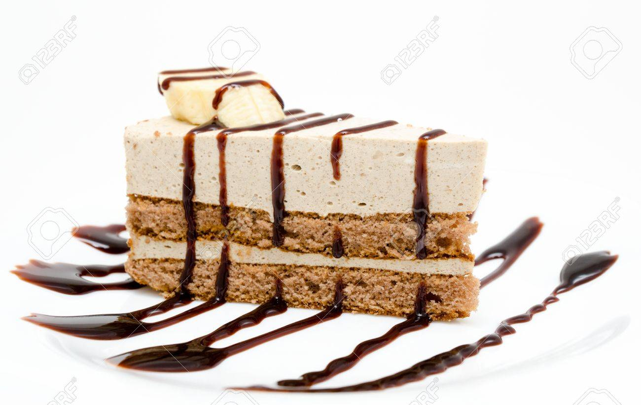 fresh cheese cake with chocolate syrup and piece of banana Stock Photo - 19382411