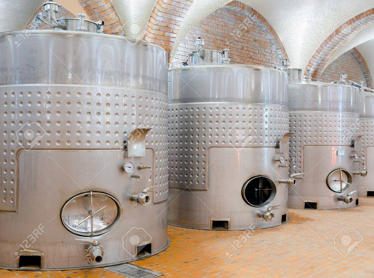line of several steel tanks at winery Stock Photo - 19382763