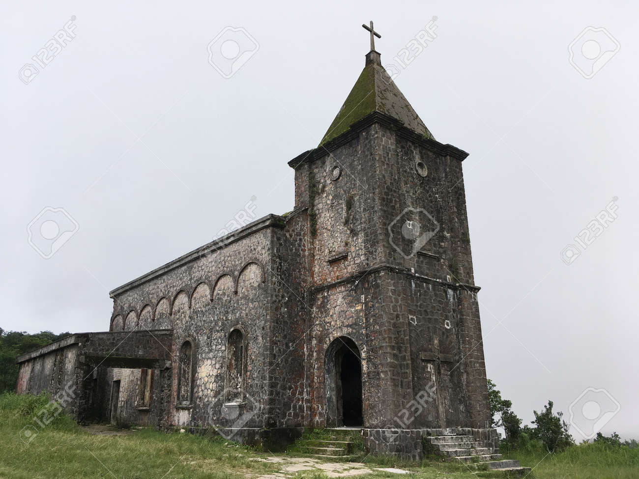 A ruined old catholic church at Bokor mountain near Kampot in Cambodia. The mountain used to be a French colonial hill station resort and site of a royal summer vacation home. - 166666323