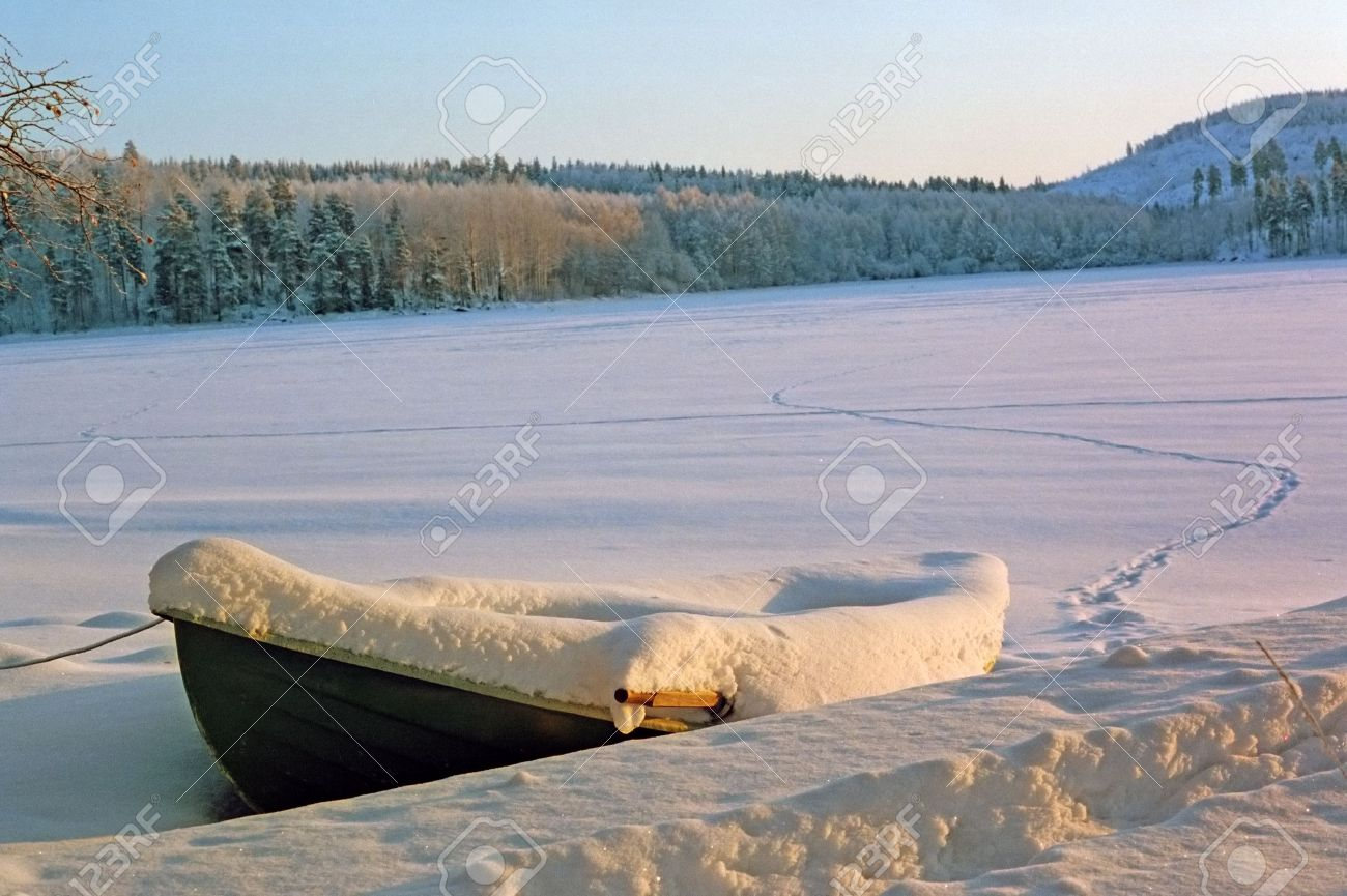 boat under snow on a frozen lake Stock Photo - 249546