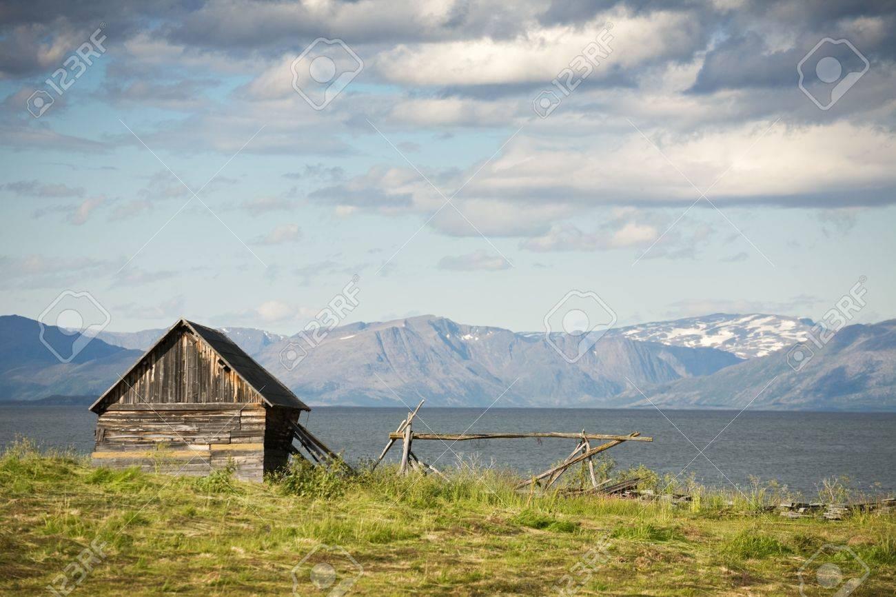 Small wooden house on sea coast. North Sea, Norway Stock Photo - 3654983