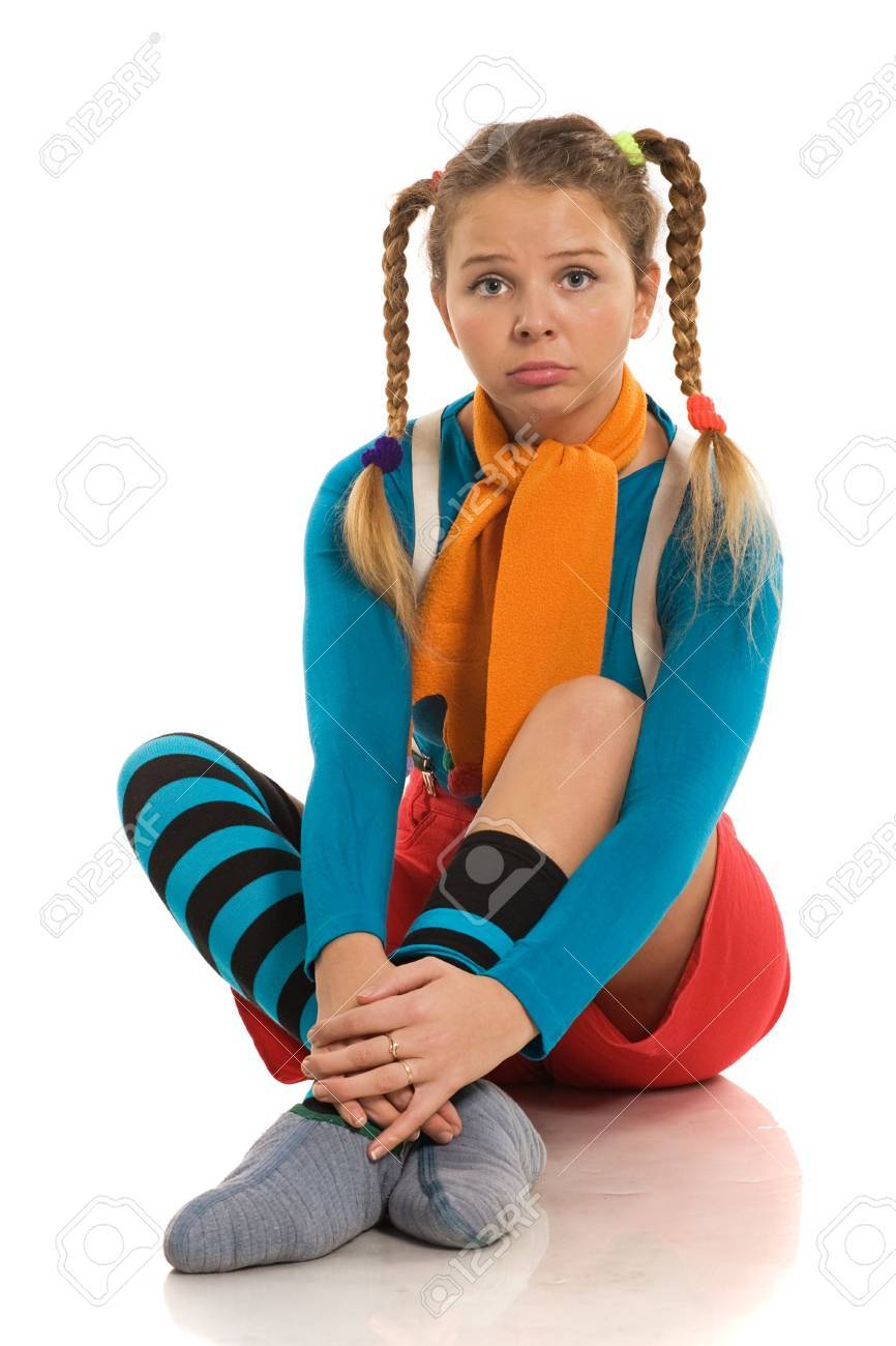 beautiful sad girl in colour cheerful clothes sitting on the floor Stock Photo - 3929609