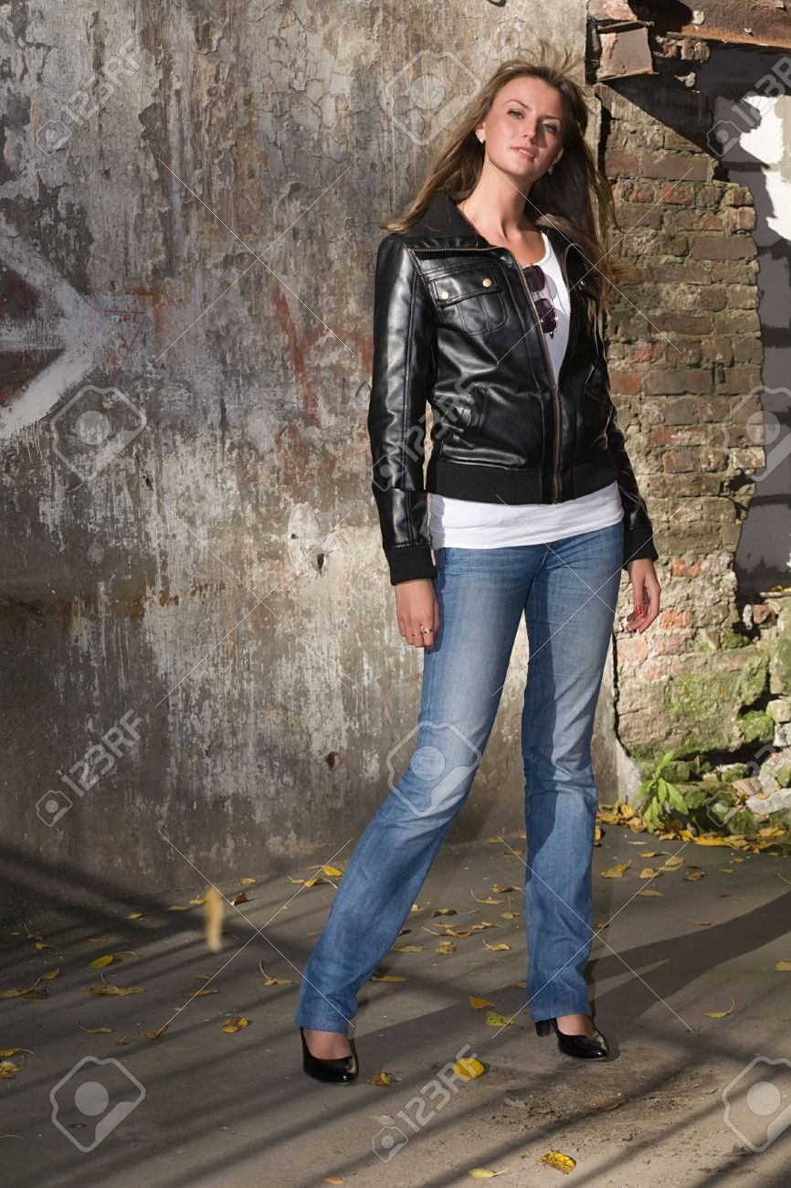 Beautiful Girl In Jeans And A Black Leather Jacket Standing Before