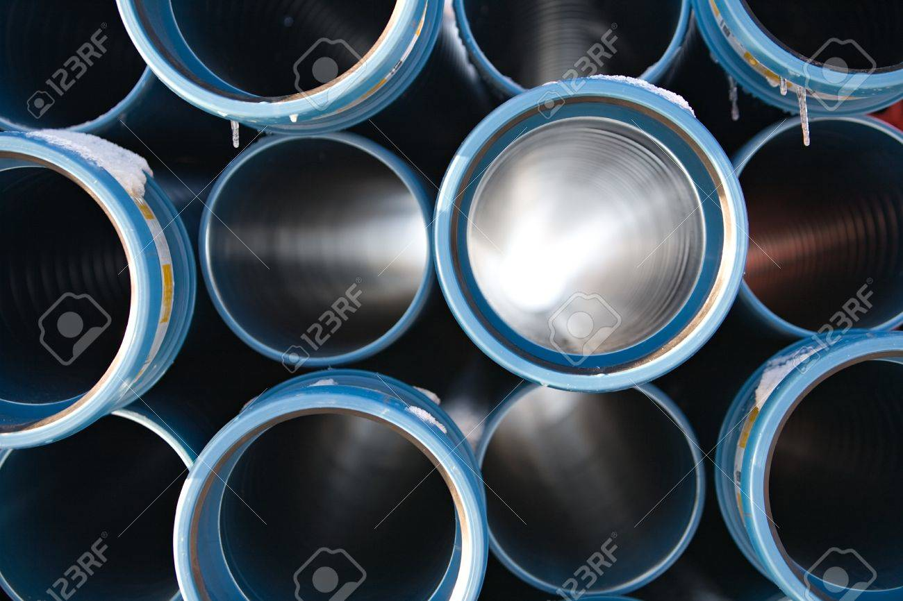 blue pipes stacked in construction site, pattern closeup Stock Photo - 4211283