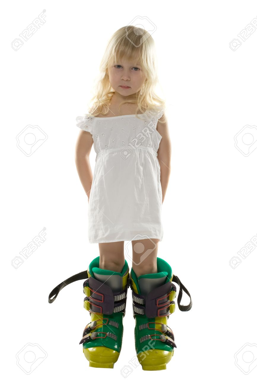 little girl in a white dress and big ski boots holds hands behind the back, isolated on white Stock Photo - 4448248
