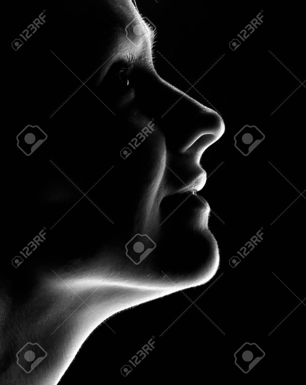 young woman fine-art high-contrast portrait in backlight Stock Photo - 4439994