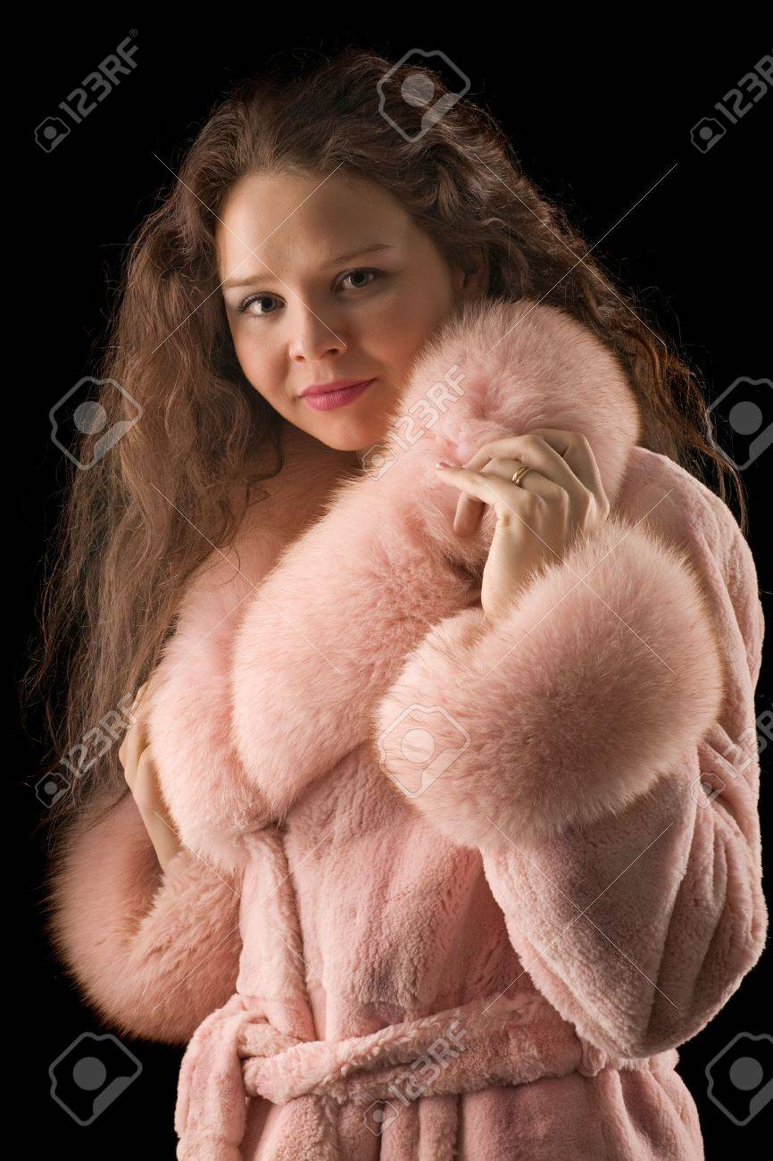 A Beautiful Romantic Girl In A Pink Fur Coat With Long Hair Looks