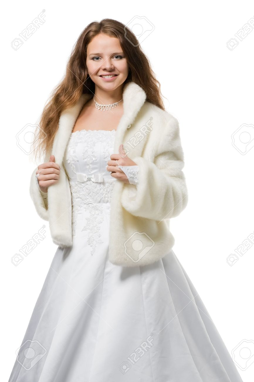 ea0f696ad7e29 beautiful bride with long hair in a wedding dress fur coat looks in the  camera