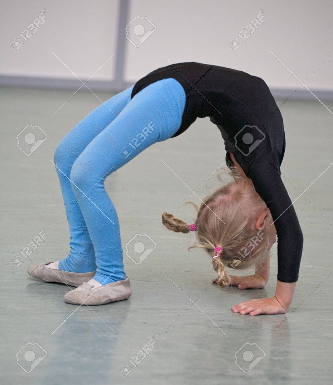 little gymnast girl on training in gym Stock Photo - 7916333