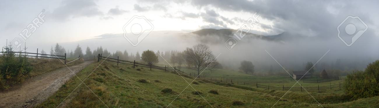 Misty daybreak in autumn Carpathian mountain, Ukraine. Ten shots stitch image. Stock Photo - 2523488