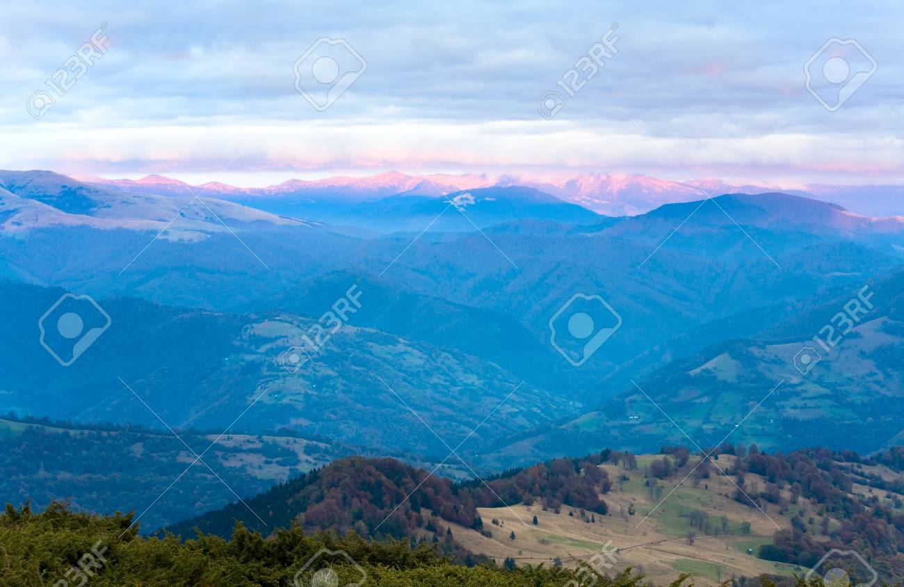 Autumn evening plateau landscape with lust golden-pink sunlight on mountains and evening glow in sky Stock Photo - 10548727