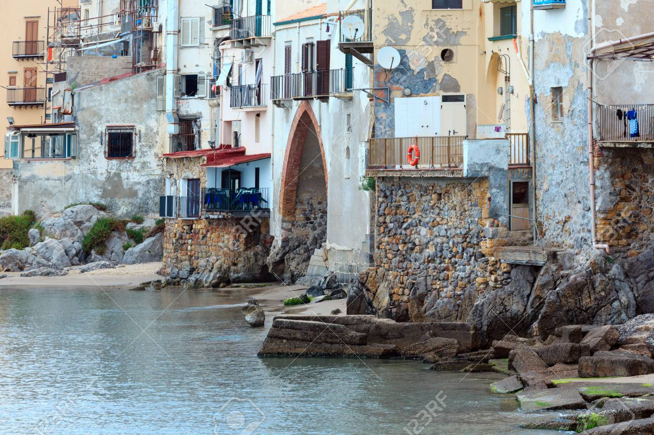 Cefalu old beautiful town houses above beach view, Palermo region,..