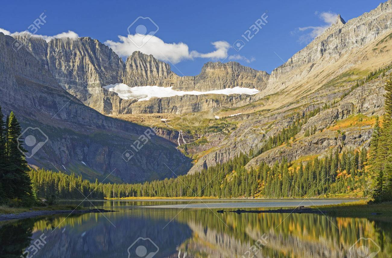 early morning light on lake josephine mt grinnell and the