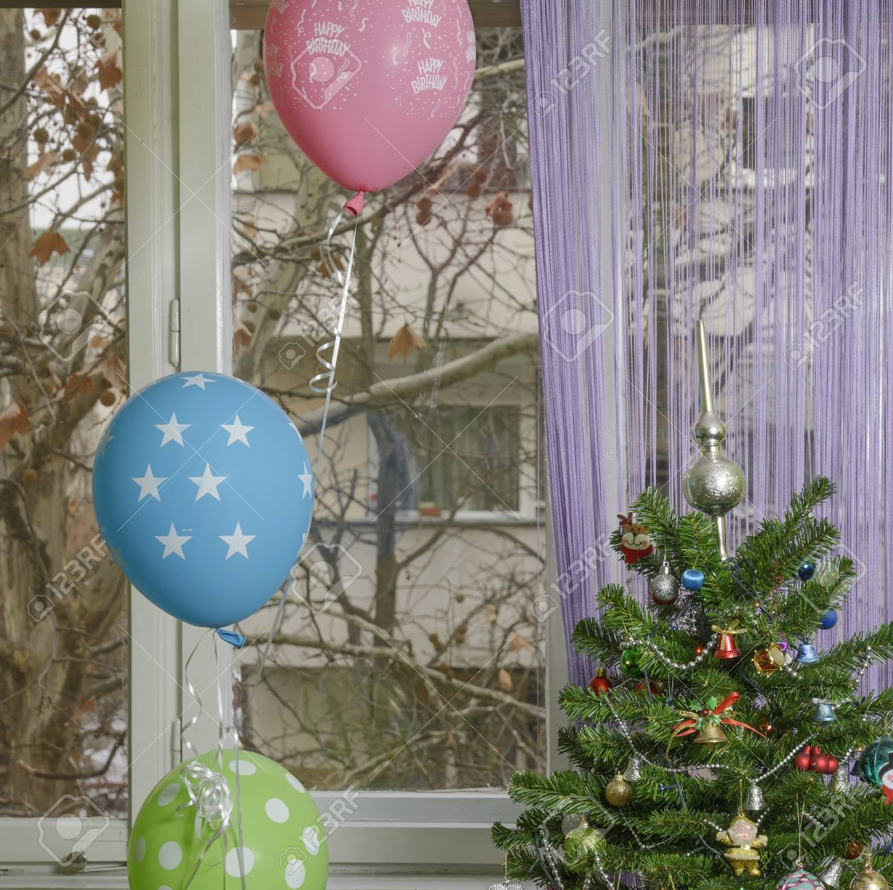 Winter Birthday Christmas Tree With Balloons Beside It Purple