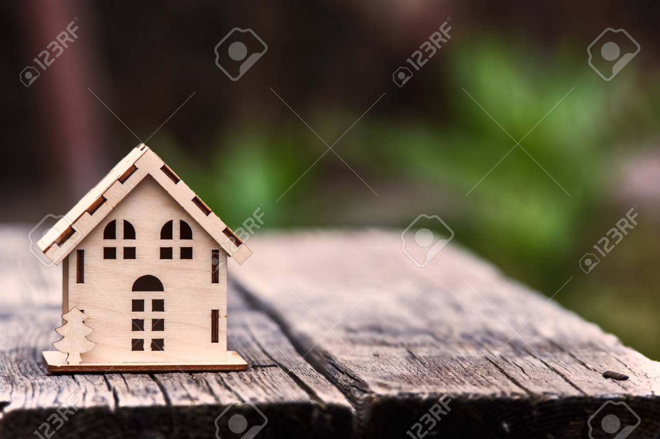 Toy House On A Beautiful Background Symbol Of Happiness Family