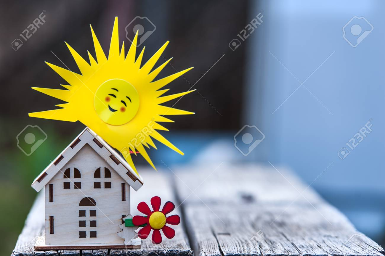 Toy House With A Sun On A Beautiful Background Symbol Of Happiness