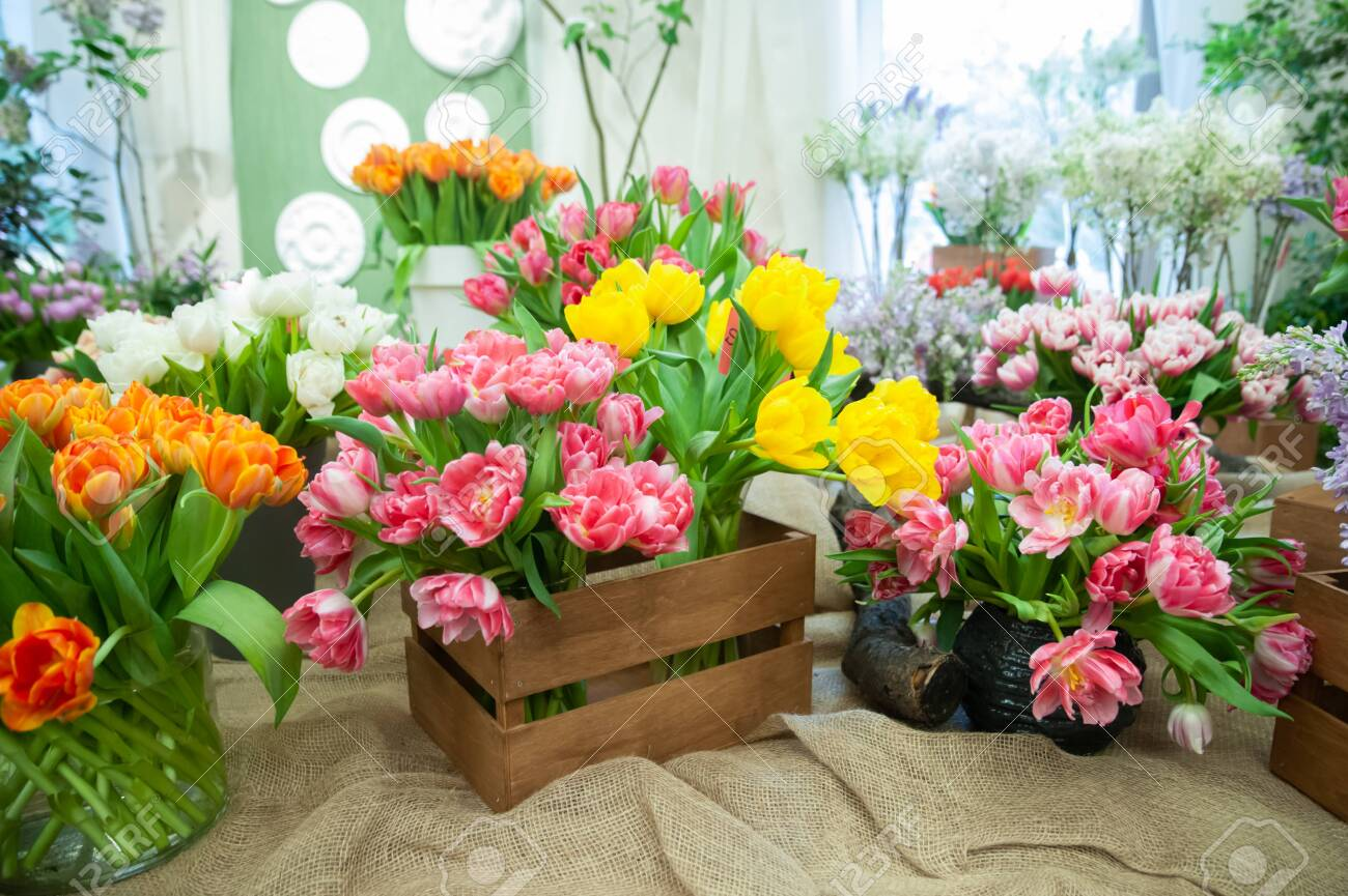 Flower shop, sale of flowers. Beautiful blooming composition of colorful tulips, Bright colorful tulip photo background, - 139267067