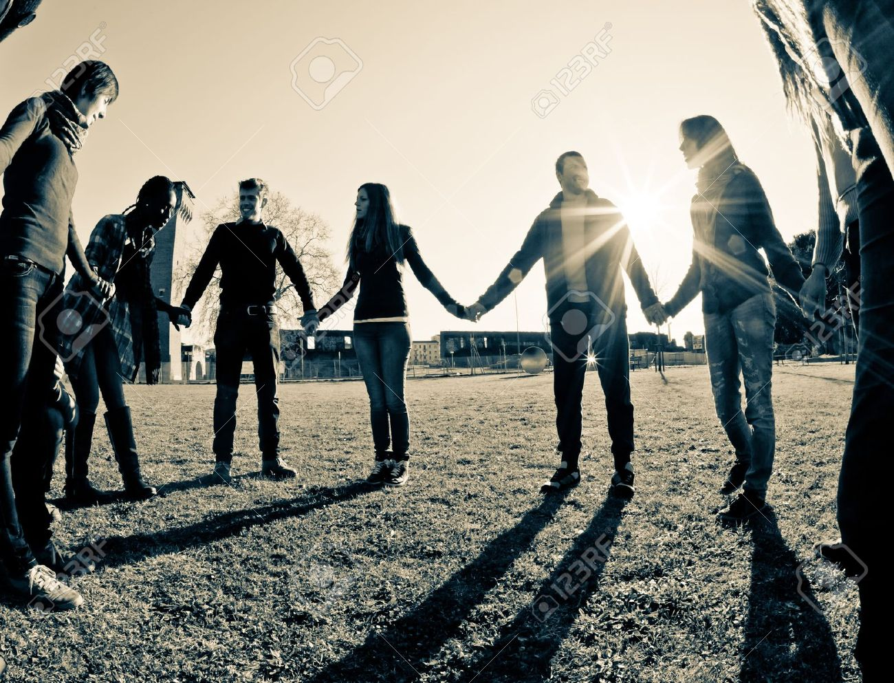 Multiracial Young People Holding Hands in a Circle Stock Photo - 10464752
