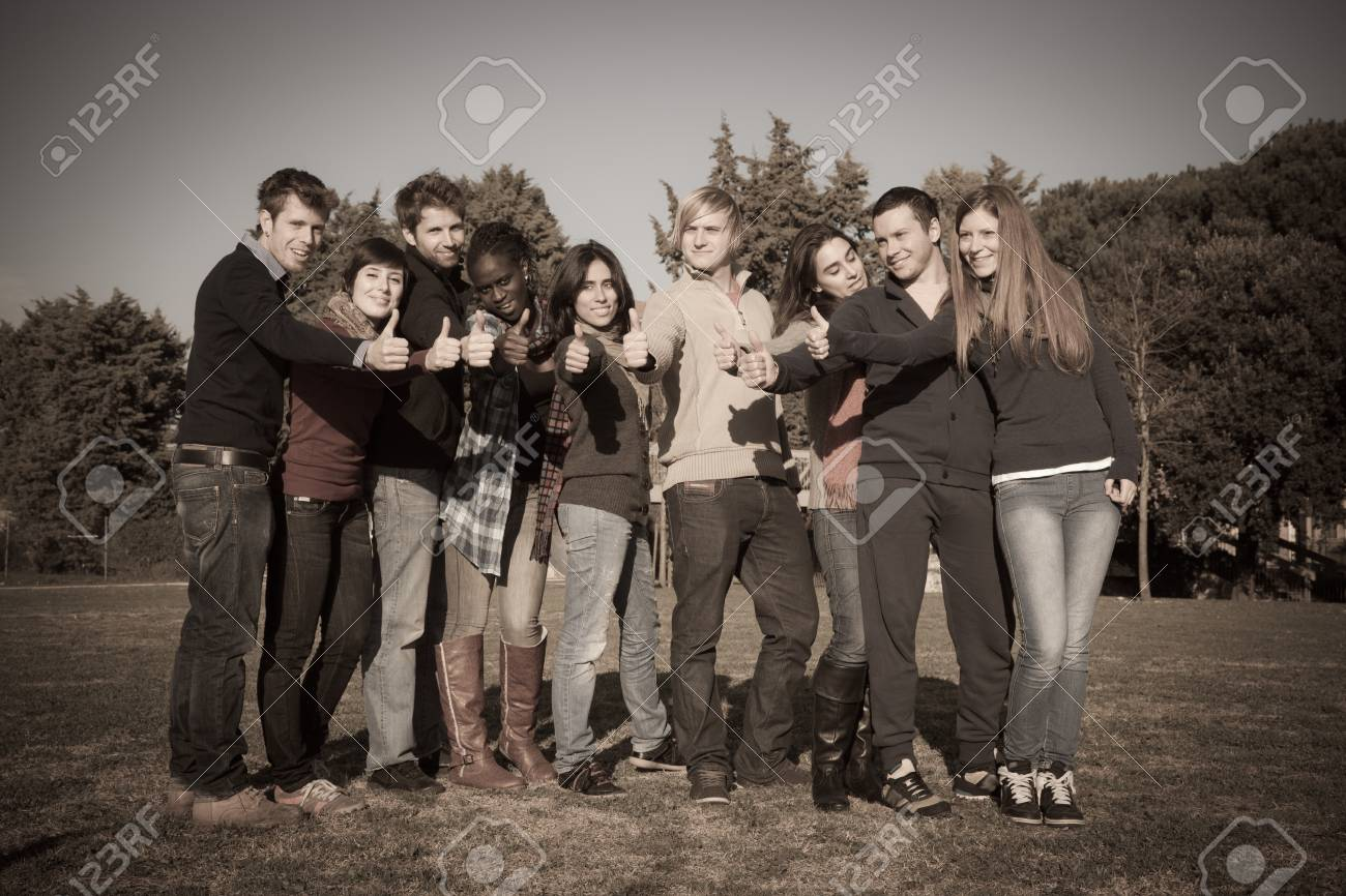 Happy College Students with Thumbs Up Stock Photo - 10464467