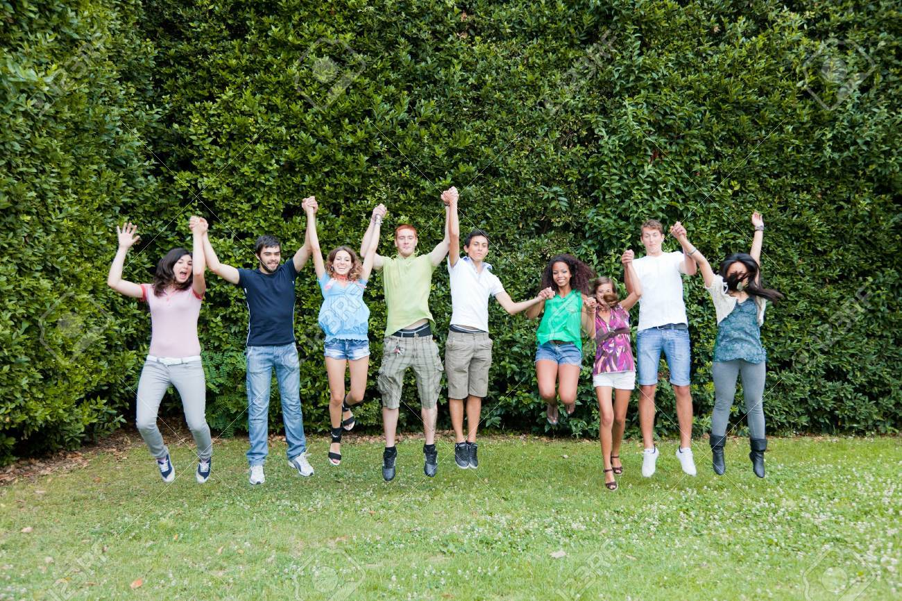 Happy Teenage College Students Jumping At Park Stock Photo ...